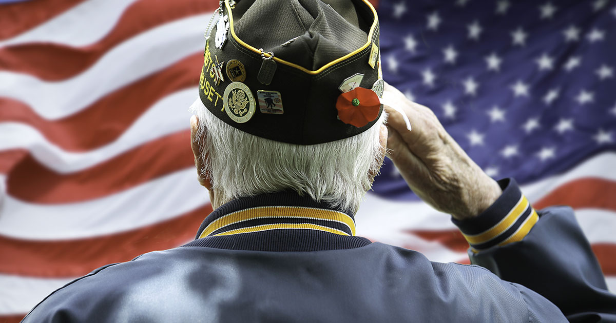 Veteran Saluting U.S. Flag